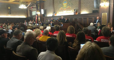 Activists and others look on as the state House Judiciary Committee votes Tuesday morning.