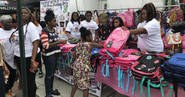 Hundreds lined up along North 22nd Street outside of Saudia Shuler's restaurant for the 11th annual book bag giveaway.