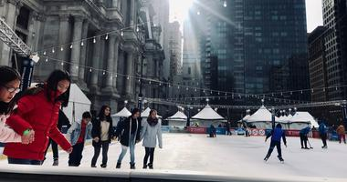 Visitors enjoy ice skating at Dilworth Park on Christmas Day.
