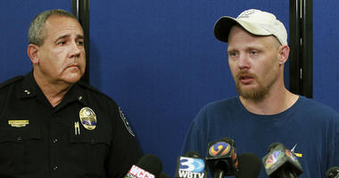 Gastonia Police Chief Robert Helton, left, listens as Ian Ritch speaks during a press conference Wednesday, Sept. 26, 2018, in Gastonia, N.C., about his 6-year-old son Maddox Ritch.