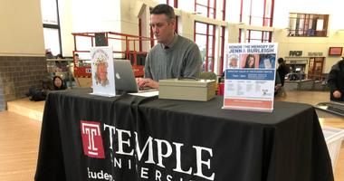 Chris Carey, Senior Associate in the Dean of Students Office, mans the donation booth in Jenna Burleigh's memory, which collects toiletries for the homeless.