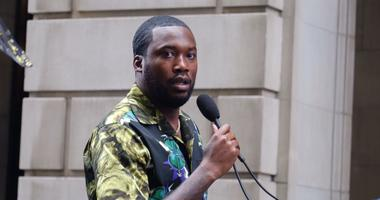Meek Mill addresses his supporters outside the Criminal Justice Center after negotiating a plea agreement in his 12-year-old court battle.