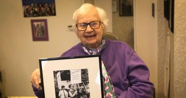Kay Tobin-Lahusen holds a photograph she took of her partner and fellow activist Barbara Gittings.
