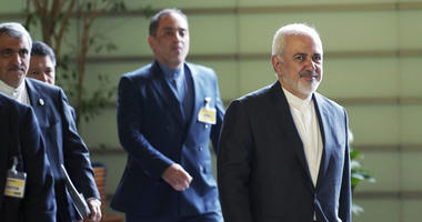 Iranian Foreign Minister Mohammad Javad Zarif, right, walks to meet Japanese Prime Minister Shinzo Abe at Abe's official residence in Tokyo Thursday, May 16, 2019.