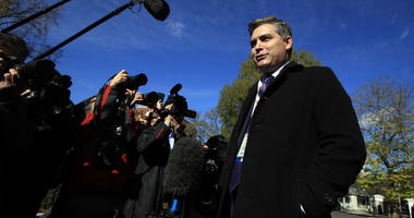CNN's Jim Acosta speaks to journalists on the North Lawn upon returning back to the White House in Washington, Friday, Nov. 16, 2018.