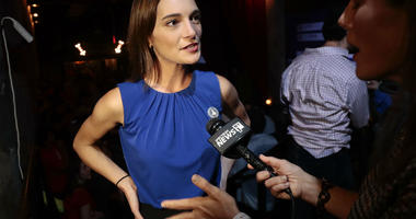 Julia Salazar, left, answers questions during an interview after winning the Democratic primary over Martin Dilan in New York's 18th State Senate district race, Thursday, Sept. 13, 2018, in New York.
