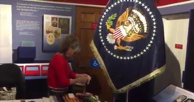 Linda Farrell, a lifelong seamstress, said it takes three months to make just one flag.