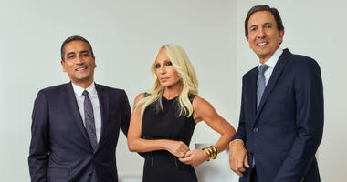 This undated photo provided by Michael Kors shows from left, CEO of Versace Jonathan Akeroyd, Donatella Versace, and chairman and CEO of Michael Kors John D. Idol.