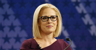 In this Oct. 15, 2018 file photo, U.S. Rep. Kyrsten Sinema, D-Ariz., goes over the rules in a television studio prior to a televised debate with U.S. Rep. Martha McSally, R-Ariz., in Phoenix.