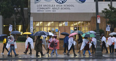 Los Angeles Unified District teacher brave the pouring rain to join in a picket line during a citywide teacher strike in front of Los Angeles High School on Monday, Jan. 14, 2019.