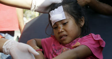 A girl injured in an earthquake is treated in Mataram, Lombok, Indonesia, Thursday, Aug. 9, 2018. The Indonesian island of Lombok was shaken by a third big earthquake in little more than a week Thursday.