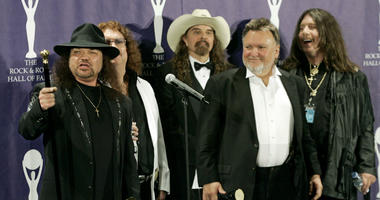 In this March 13, 2006 file photo, members of Lynyrd Skynyrd, from left, Gary Rossington, Billy Powell, Artimus Pyle, Ed King and Bob Burns, appear backstage after being inducted at the annual Rock and Roll Hall of Fame dinner in New York.