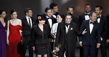 """Amy Sherman-Palladino, front and center left, Daniel Palladino and the cast and crew of """"The Marvelous Mrs. Maisel"""" accept the award for outstanding comedy series at the 70th Primetime Emmy Awards."""