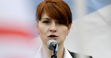 In this April 21, 2013 file photo, Maria Butina, leader of a pro-gun organization in Russia, speaks to a crowd during a rally in support of legalizing the possession of handguns in Moscow, Russia.
