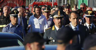 Interior Minister Matteo Salvini, center, arrives at the site where the Morandi highway bridge collapsed, in Genoa, northern Italy, Wednesday, Aug. 15, 2018.