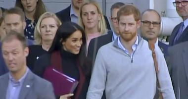 In this image made from video, Britain's Prince Harry, center right, and his wife Meghan, center left, Duke and Duchess of Sussex, approach a car at an airport in Sydney, Monday, Oct. 15, 2018.