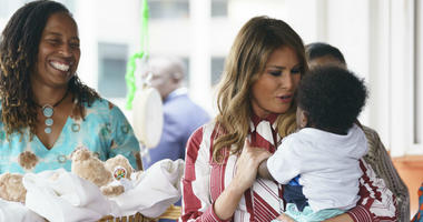 First lady Melania Trump holds a baby as she visits Greater Accra Regional Hospital in Accra, Ghana, Tuesday, Oct. 2, 2018.