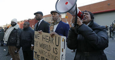 U.S. Rep. Yvette Clarke, D-New York, stands beside Brooklyn Borough President Eric Adams, with family members, protesters, and activists holding a vigil outside the Metropolitan Detention Center, Sunday, Feb. 3, 2019, in New York.