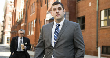 Former East Pittsburgh police officer Michael Rosfeld, charged with homicide in the shooting death of Antwon Rose II, walks to the Dauphin County Courthouse in Harrisburg, Pa., Tuesday, March 12, 2019.