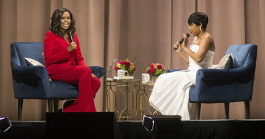 "Former first lady Michelle Obama, left, is interviewed by Phoebe Robinson during the ""Becoming: An Intimate Conversation with Michelle Obama"" event at the Wells Fargo Center on Thursday, Nov. 29, 2018, in Philadelphia."