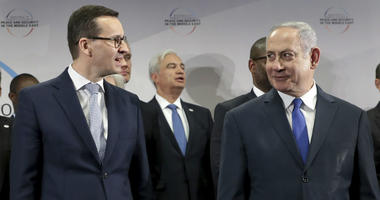 Poland's Prime Minister Mateusz Morawiecki, left, and Israeli Prime Minister Benjamin Netanyahu, right, attend a group photo during a meeting in Warsaw, Poland.