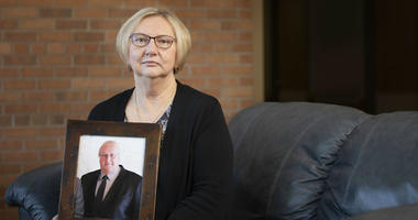 Nancy Buchholz holds her husband Jeff's picture, who died six weeks after being diagnosed with cancer this spring.