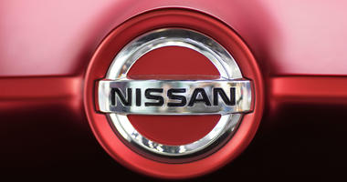 This June 14, 2018, file photo, shows a Nissan logo on a Nissan Concept 2020 Vision Gran Truismo on display at the automaker's showroom in Tokyo.