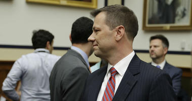 """FBI Deputy Assistant Director Peter Strzok, center, arrives to a hearing of the House Committees on the Judiciary and Oversight and Government Reform on """"Oversight of FBI and DOJ Actions Surrounding the 2016 Election,"""" on Capitol Hill."""