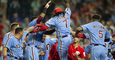 Philadelphia Phillies' Maikel Franco (7) is congratulated at home plate after hitting a walk-off three-run home run against the Miami Marlins in a baseball game Thursday, Aug. 2, 2018, in Philadelphia.