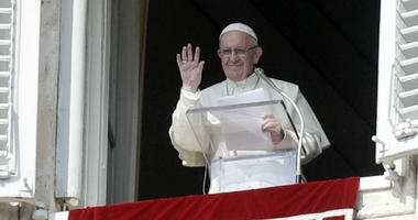 Pope Francis waves to faithful at the end of the Angelus prayer he delivered in St. Peter's Square at the Vatican, Sunday, Oct. 21, 2018.