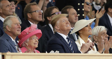 Britain's Prince Charles, Queen Elizabeth II, President Donald Trump, first lady Melania Trump and Greek President Prokopis Pavlopoulos, from left, applaud as they watch a fly past at the end of an event to mark the 75th anniversary of D-Day.