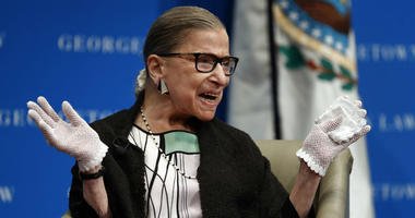 In this Sept. 20, 2017 photo, U.S. Supreme Court Justice Ruth Bader Ginsburg reacts to applause.
