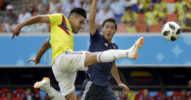 Colombia's Radamel Falcao, left, plays the ball during the group H match between Colombia and Japan at the 2018 soccer World Cup in the Mordavia Arena in Saransk, Russia, Tuesday, June 19, 2018.