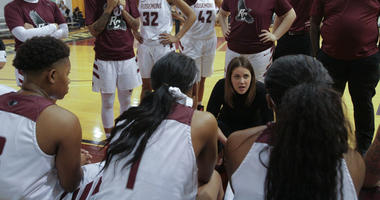 Rosemont head women's basketball coach Rayne Reber talks to her team during a timeout.
