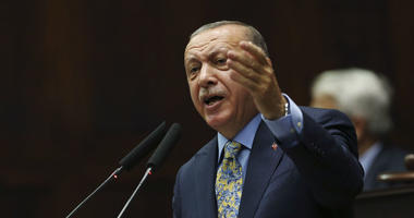 Turkey's President Recep Tayyip Erdogan gestures as he addresses members of his ruling Justice and Development Party (AKP), at the parliament in Ankara, Turkey, Tuesday, Oct. 23, 2018.
