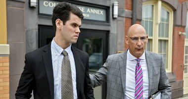 In this June 13, 2018, file photo, Ryan Burke, left, who was a fraternity brother at Penn State University's shuttered Beta Theta Pi chapter, walks with his attorney Philip Masorti.