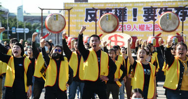 Protesters wore yellow vests and marched to Taiwan's presidential office on Wednesday, in what organizers said was a rally inspired by the French movement.