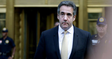 Federal prosecutors have charged an analyst with the Internal Revenue Service with illegally disclosing confidential reports about Michael Cohen's bank records that revealed that President Donald Trump's former lawyer sought to profit from his proximity t
