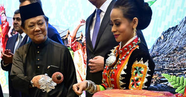Malaysia's Minister for Tourism, Art and Culture Mohamaddin Ketapi attends a welcome ceremony at a booth promoting his country during the International Tourism Trade Fair (ITB) in Berlin.
