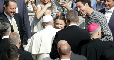 Pope Francis greets Swedish teenage environmental activist Greta Thunberg.