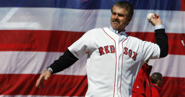 Bill Buckner throws out the ceremonial first pitch at the Boston Red Sox home opener on April 8, 2008 at Fenway Park.