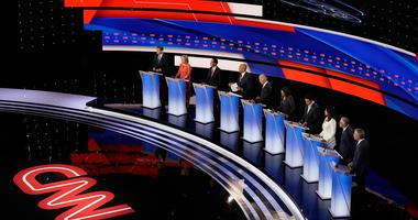 Presidential candidates Michael Bennet, Kirsten Gillibrand, Julián Castro, Cory Booker, Joe Biden, Kamala Harris, Andrew Yang, Tulsi Gabbard, Jay Inslee and Bill de Blasio participate in the CNN Democratic debate in Detroit on Wednesday, July 31.