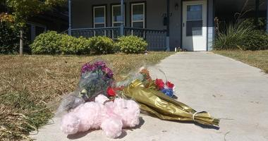 Flowers are laid out in front of the home where 28-year-old Atatiana Koquice Jefferson was shot and killed by a police officer in Fort Worth.