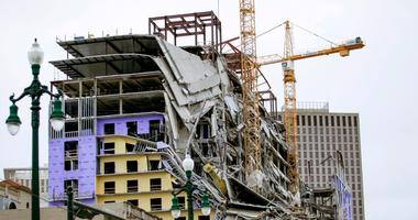 The implosion of two cranes at the Hard Rock Hotel in New Orleans, which partially collapsed during construction, was expected Saturday after a delay due to a tropical storm, officials said.