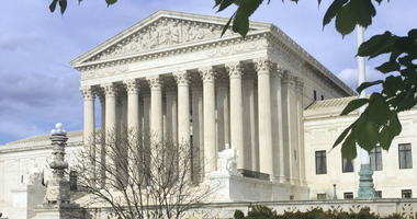 This April 23, 2018, file photo shows the Supreme Court in Washington. The Supreme Court says states can force online shoppers to pay sales tax.