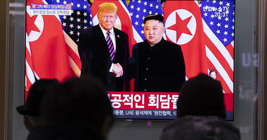 People watch a TV live broadcast on top leader of the Democratic People's Republic of Korea (DPRK) Kim Jong Un meeting with U.S. President Donald Trump in Seoul, South Korea, Feb. 27, 2019.