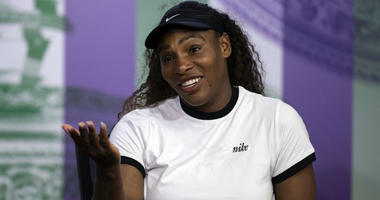 US tennis player Serena Williams reacts, during a press conference ahead of the Wimbledon Tennis Championships in London, Sunday July 1, 2018.