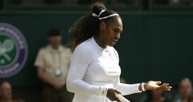 Serena Williams of the United States is dejected after losing a point to Germany's Angelique Kerber during their women's singles final match at the Wimbledon Tennis Championships, in London, Saturday July 14, 2018.