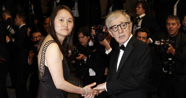 """In this Saturday, May 15, 2010, file photo, filmmaker Woody Allen, right, and Soon-Yi Previn arrive for the premiere of """"Another Year,"""" at the 63rd international film festival, in Cannes, southern France."""