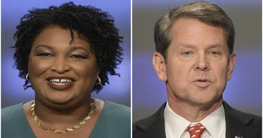 This combination of May 20, 2018, photos shows Georgia gubernatorial candidates Stacey Abrams, left, and Brian Kemp in Atlanta.